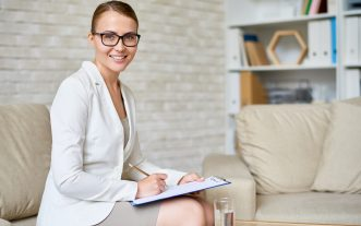 Portrait,Of,Beautiful,Female,Psychologist,Wearing,Glasses,Posing,With,Clipboard