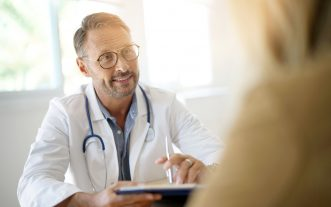 Doctor,With,Patient,In,Medical,Office